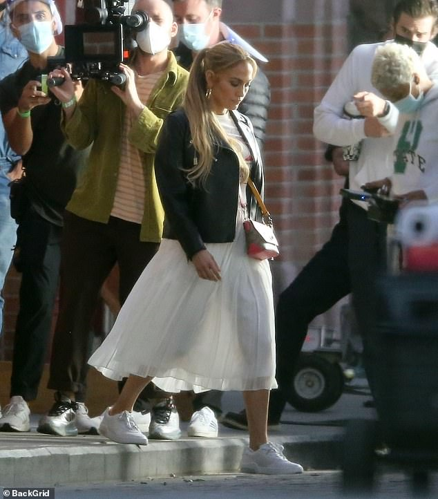 Represent:The On The Floor singer sported Coach's official 80th Anniversary Collection t-shirt, which was tucked into the waist of her white accordion skirt
