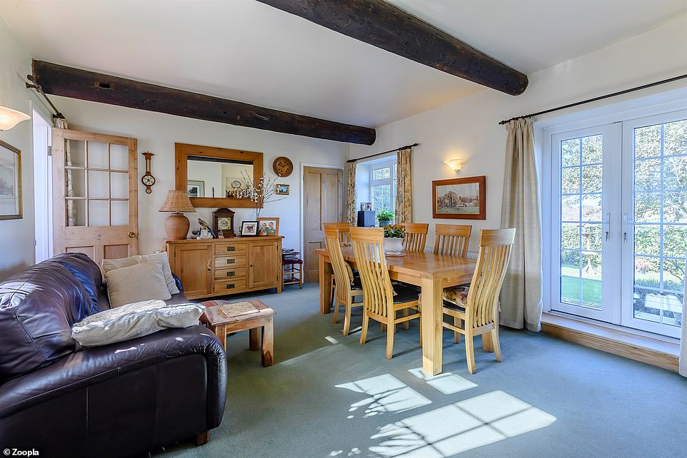 This room in the cottage has a dining area and patio doors leading to the garden