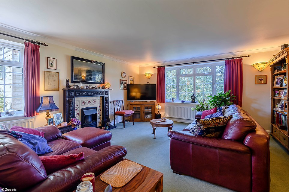 Inside the cottage, there are three reception rooms, including this living area