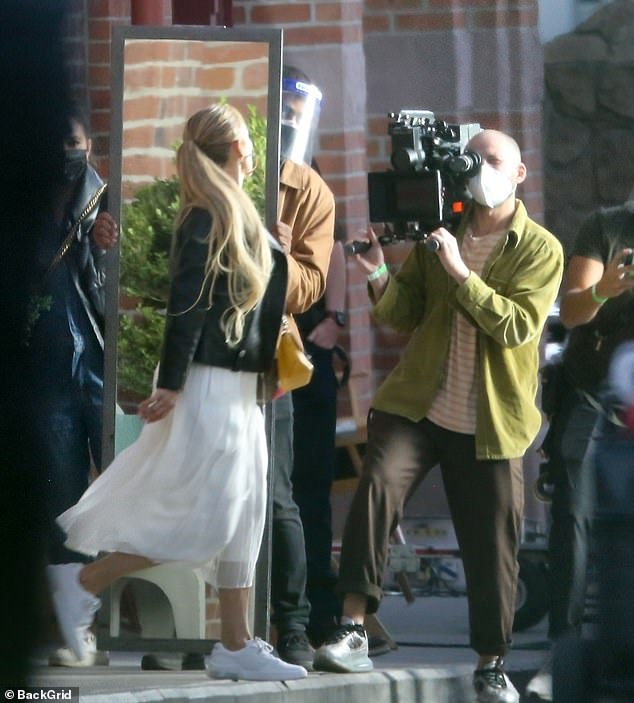 Elegant:Jennifer's golden hair was tied back into a chic ponytail that gracefully flowed down her back
