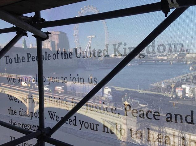 The activists posted a video from the top of the scaffolding after they had unveiled the banner (pictured)