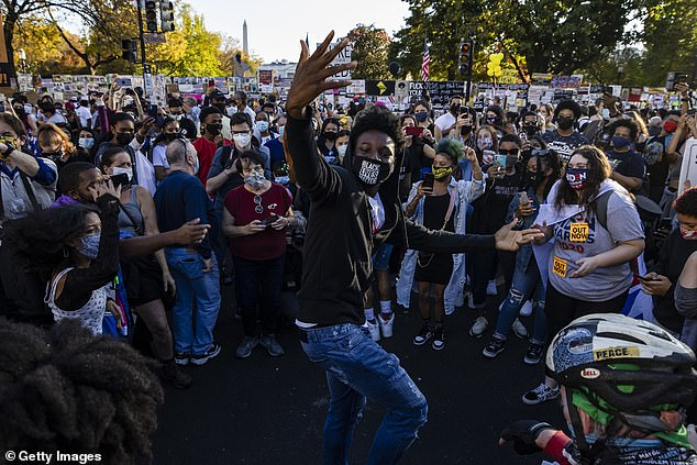 Black Lives Matter supporters pictured celebrating Biden's victory on Sunday near the White House