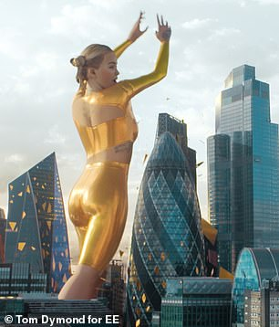 Amazing: Rita was superimposed into London's landscape for EE's newest advert in her bold look
