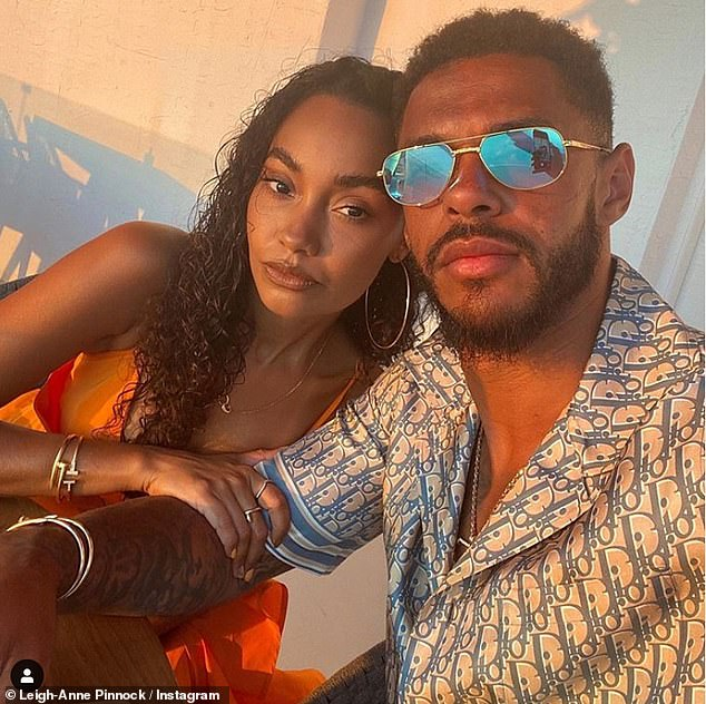 Smitten:Leigh-Anne Pinnock put on a loved-up display with fiancé Andre Gray on Friday as she reflected on their engagement story and how she made the first move in their romance