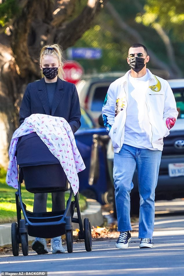 Fall fashion: Sophie Turnermade the road her runway in a black striped blazer on a walk with three-month-old daughter and husband Joe Jonas in Los Angeles on Thursday