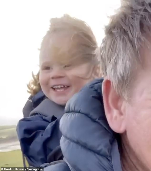 Happy days:The toddler looked ecstatic as he giggled as his Dad took him along for the ride
