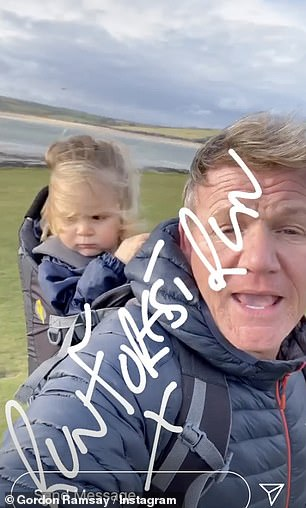 Doting dad: The TV chef, 54, took to his Instagram story to show the toddler - who is just 19 months old - enjoying the fresh air as the wind blew in his face