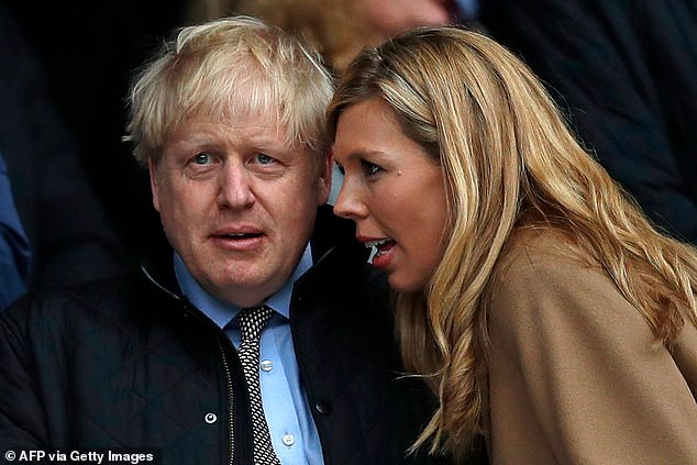 Boris Johnson's ousted aides have privately predicted the 'beginning of the end' for the Prime Minister following the extraordinary row which broke out over the influence of Carrie Symonds (pictured with the Prime Minister in March)