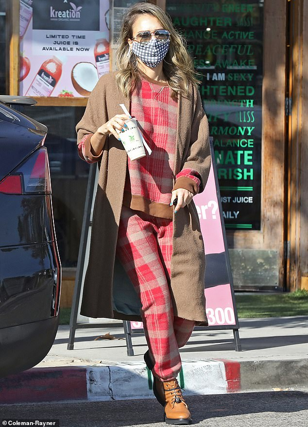 On the go: Jessica Alba was spotted putting a dapper spin on California casual while out in sunny Los Angeles this Wednesday