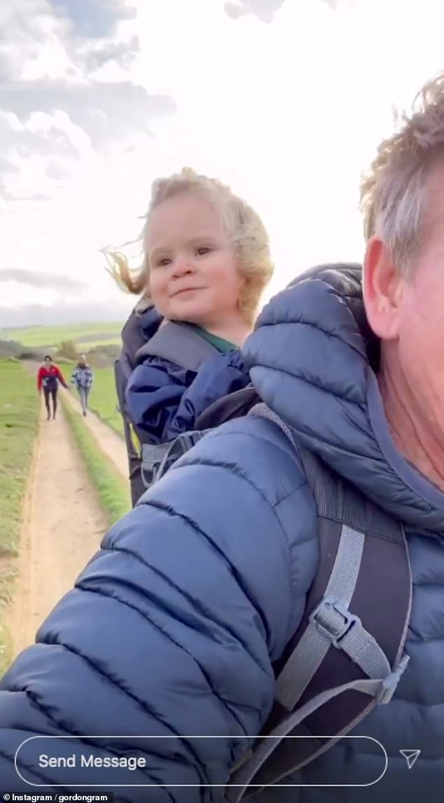Delighted:Gordon shared footage of himself and Oscar as they headed out for some exercise together, with the chef's little one pulling amusing faces