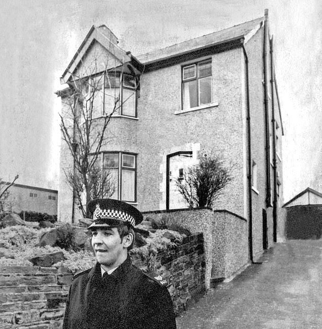 ON GUARD: A police officer outside the Ripper¿s house in January 1981.Neighbours in Garden Lane say Sonia is regularly at the house. One said: ¿I saw her there on Thursday night.¿