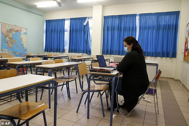Greece closed schools and nurseries yesterday in a bid to stem rising infection rates. Pictured: A teacher giving an online lesson to students inGreece, Athens