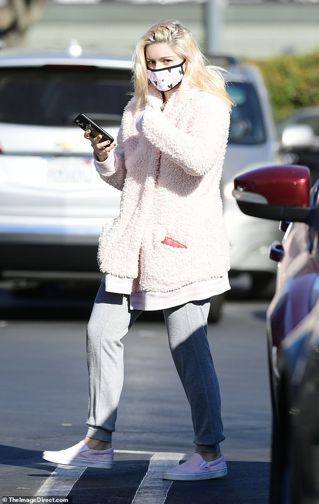Ariel Winter keeps it casual but stylish in pink furry coat and grey sweatpants during a grocery run