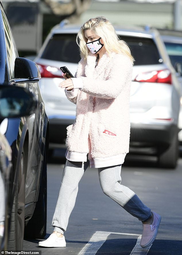 On the go: The Modern Family star looked casual but stylish in a light pink furry coat, grey sweatpants and light pink sneakers