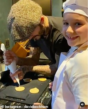 Delighted: Harper smiled brightly as she baked cookies with her dad