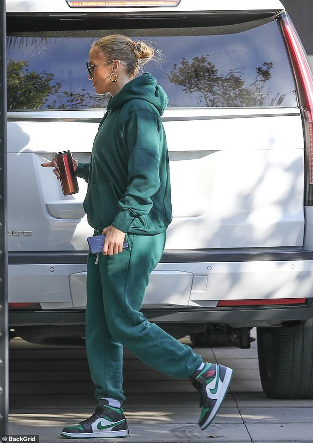 Super coordinated:Her hoodie and sweatpants were the same shade of deep green, and she wore Jordan 1 Retro High Lucky Green hightop sneakers on her feet