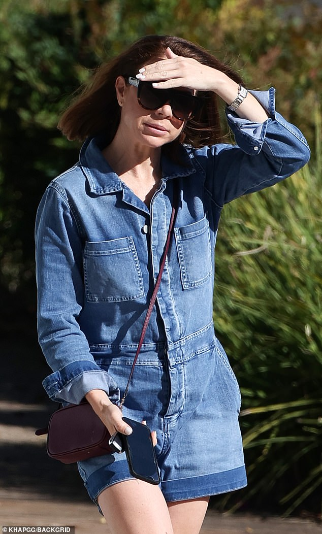 Forgetting something? Kate Ritchie, 42, (pictured) emerged without her wedding ring in Sydney on Saturday - following reports she and husband Stuart Webb were getting counselling for their issues