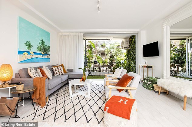 Transformation: In the two years that they owned the apartment, property flippers Mark, 58, and Mitch, 57, renovated the two-bedroom oasis to give it a more beachy feel