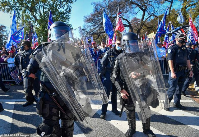 US Capitol Police maintain order in a skirmish line to separate counter-protesters from the Million MAGA March