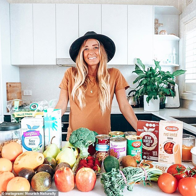 A leading dietitian has revealed the foods she keeps in her pantry, and the foods you need to add to your shopping list to stay healthy all year round (Rebecca Gawthorne pictured)