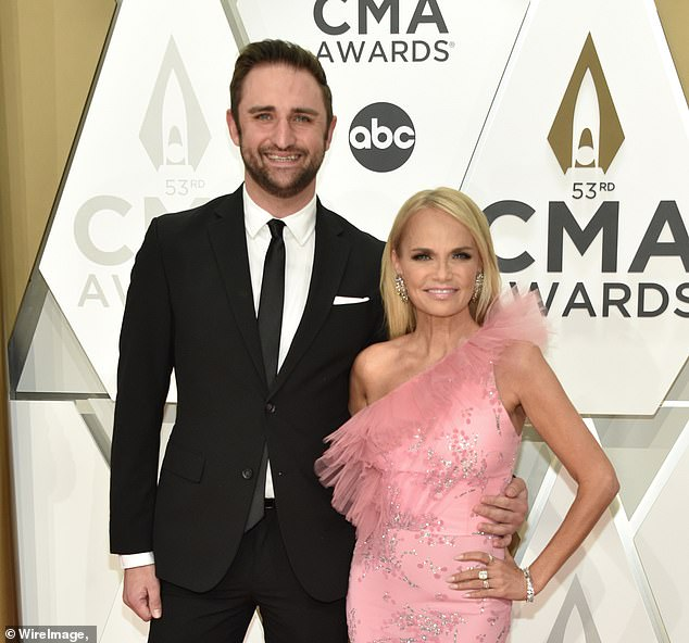 Keeping busy: Kristin Chenoweth revealed how she and beau Josh Bryant have been able to make it work in quarantine; the couple are pictured at the CMA Awards in November 2019