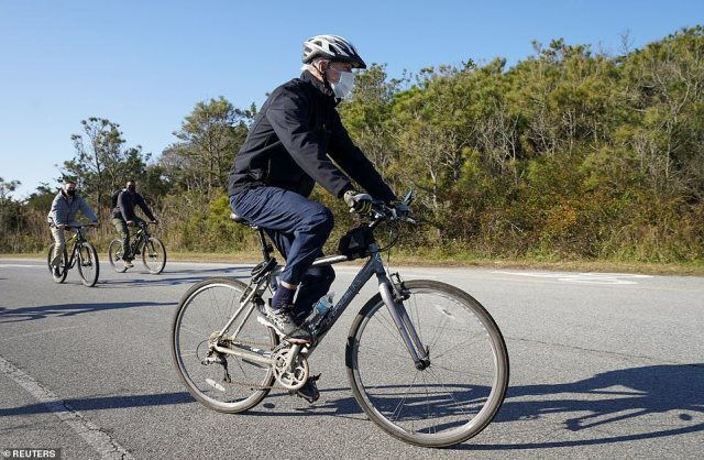 U.S. President-elect Joe Biden goes for a bike ride at Cape Henlopen State Park in Rehoboth Beach, Delaware on Saturday