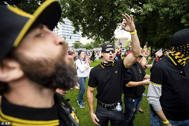 She claimed that the white supremacists drove around the city. Pictured, members of the Proud Boys rally during an 'End Domestic Terrorism' protest in Portland in 2019