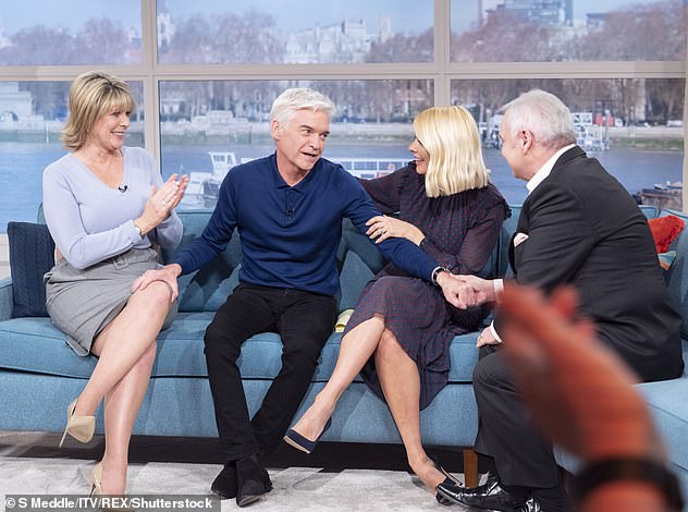 Comfort: In the new autobiography, the media personality praises Eamonn and Ruth for publicly comforting him when he made he came out as gay(pictured)