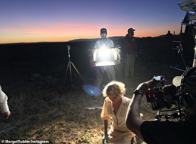 Work it: Another frame showed Margot kneeling in the desert at twilight which crew captured the scene