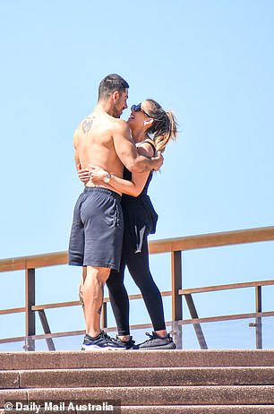 Celebrations: Following their workout, Jono and Amy were seen embracing each other while their adorable puppy, Oli, watched on