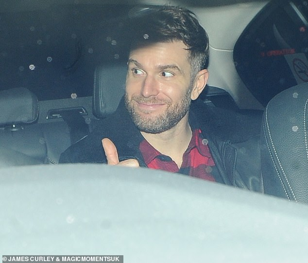 Rare night out: Joel Dommett also attended Saturday's episode in a red and black check shirt