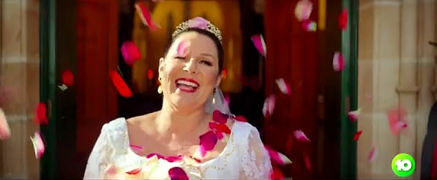 You're terrible: Julia frocked up in a wedding gown to recreate a scene from Muriel's Wedding