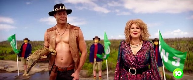 Stripped off:In the clip, Chris first goes shirtless as he wears a Crocodile Dundee costume, embodying the character made famous by Paul Hogan
