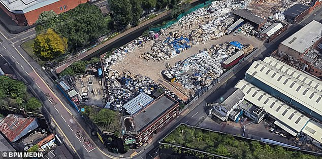 Mr Khan had climbed onto the top of the huge baler, used to crush cardboard, after it had become blocked but fell into the machine and suffered fatal injuries. Pictured is an aerial view of the recycling site
