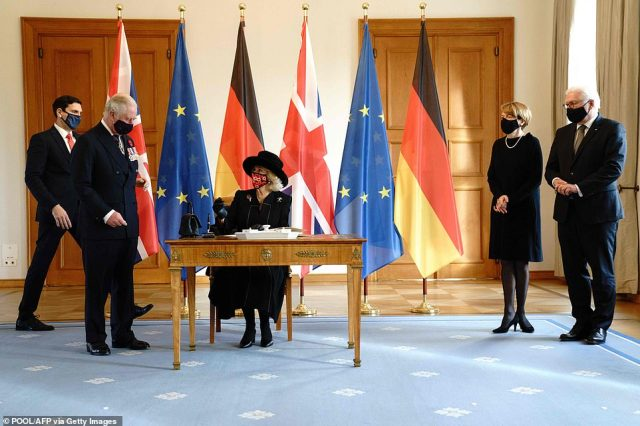 Prince Charles and the Duchess of Cornwall are led to sign the guest book at thepresidential Bellevue palace, whilePresident Frank-Walter Steinmeier and the First Lady look on