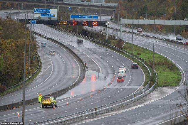 The M20 is partly flooded near Maidstone in Kent. Over one hundred flood alerts are put in place by the Met Office today as the UK is hit with heavy overnight rain and gale force winds