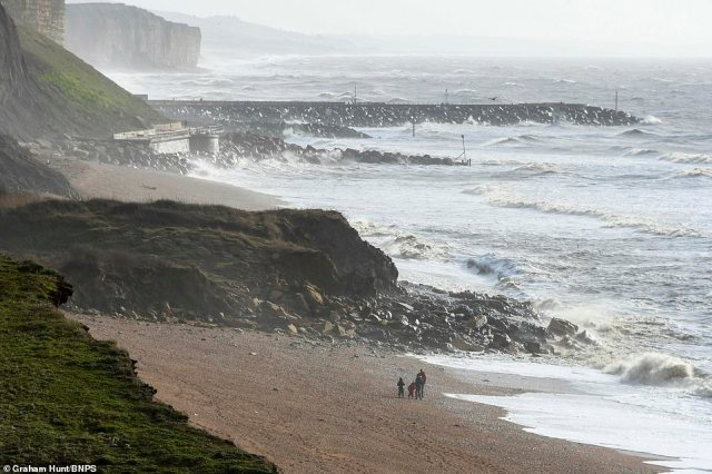Heavy rain and gale force winds have been forecast to batter the country during the UK's second weekend in its second national lockdown. Pictured: A large section of cliff at a Jurassic Coast beauty spot has collapsed overnight