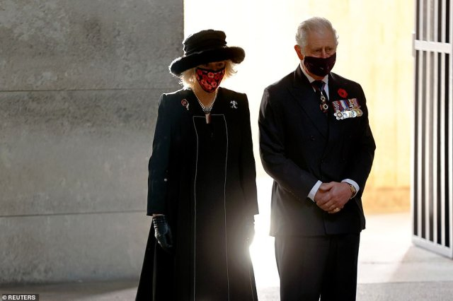 Prince Charles and the Duchess of Cornwall pay their respects during a wreath laying ceremony at the Neue Wache memorial to mark Remembrance Day in Berlin