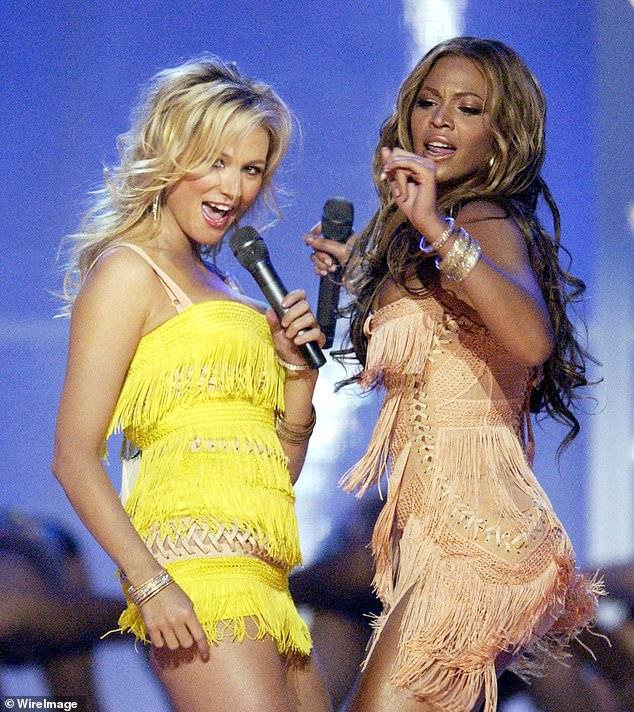 Thankful: Jewel (left) has revealed that her performance on the 2003 VH1 Divas Duets special (pictured) would have been a disaster if not for Beyoncé (right). The women shared the stage to perform Proud Mary - and the nervous folk singer struggled with the choreography