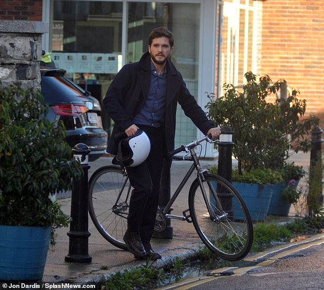 Cyclist: Instead of Jon Snow's famously shaggy mane of hair, the Brimstone actor was sporting a much neater crew cut with a short moustache and beard