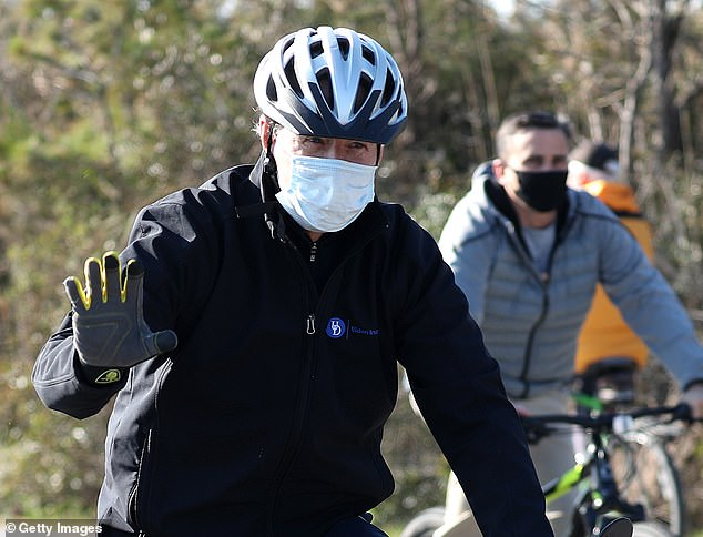Joe Biden has been staying at a vacation home in Rehoboth Beach, Delaware as he works on his transition. Here he is seen taking a bike ride on Saturday in Lewes, Delaware – near the vacation home