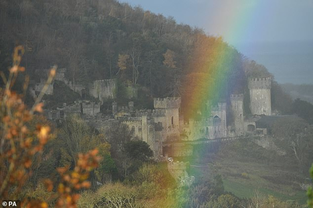 New beginnings: A rainbow was seen over the Grade I listed 19th century castle hours before the show kicked off