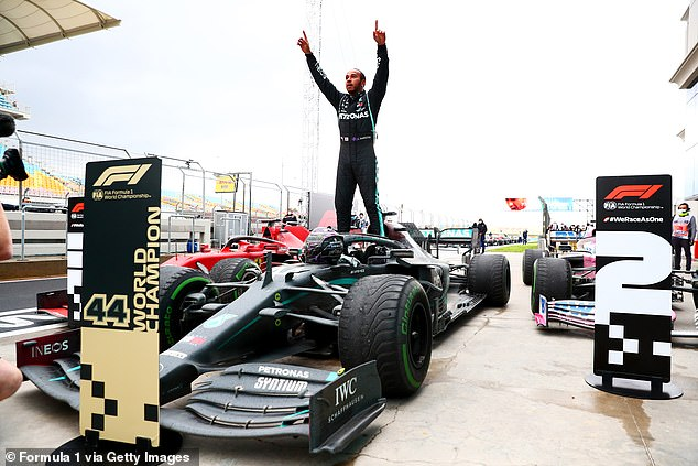 Mercedes driver Hamilton (above) won the Turkish Grand Prix in Istanbul on Sunday to seal the title