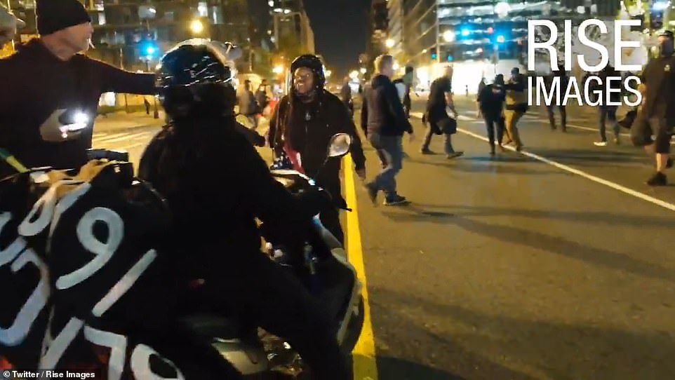 The woman is accompanied by another BLM supporter on a scooter who also chimes in with abuse to the Proud Boys before her friend is knocked out