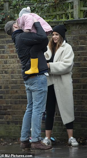 Adorable:India, who Binky shares with ex Joshua Patterson, looked cute in a pink jacket, grey hat and yellow wellington boots