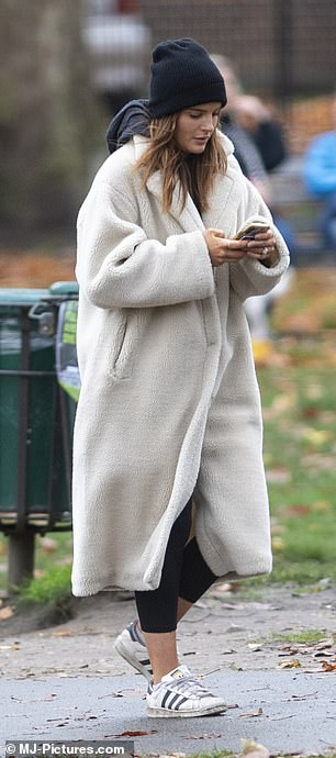 Style: Binky cut a typically chic figure as she stepped out for the day in a fleecy coat