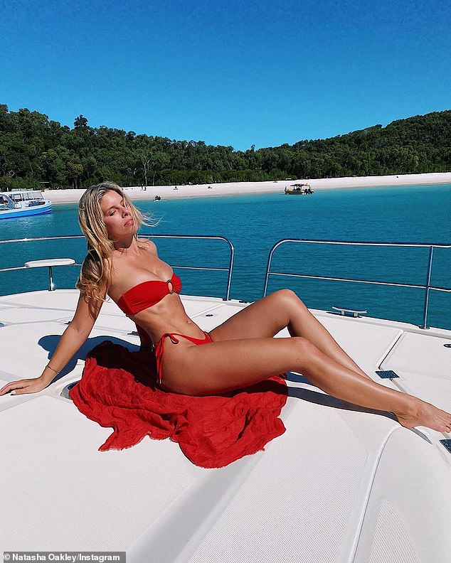 A-list: Becky was in the company of the likes of bikini model Natasha Oakley (pictured)