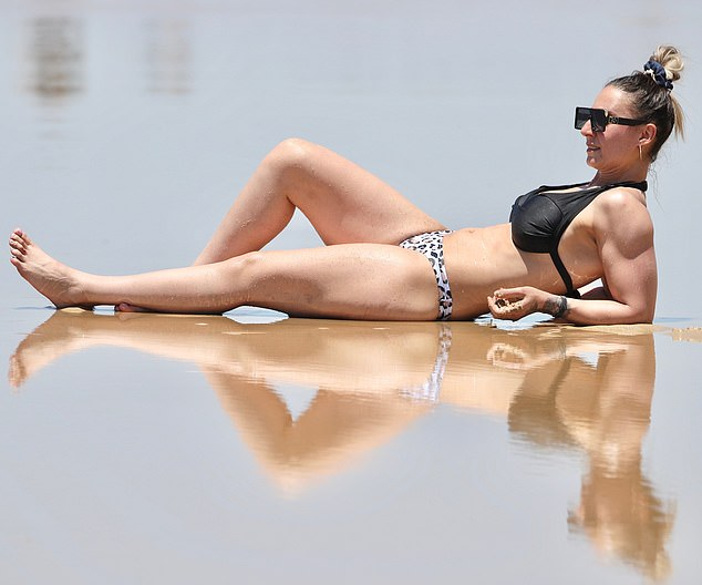 Alright for some! Married At First Sight star Amanda Micallef, 34, was spotted relaxing at the beach on the Gold Coast after relocating from Melbourne to Queensland