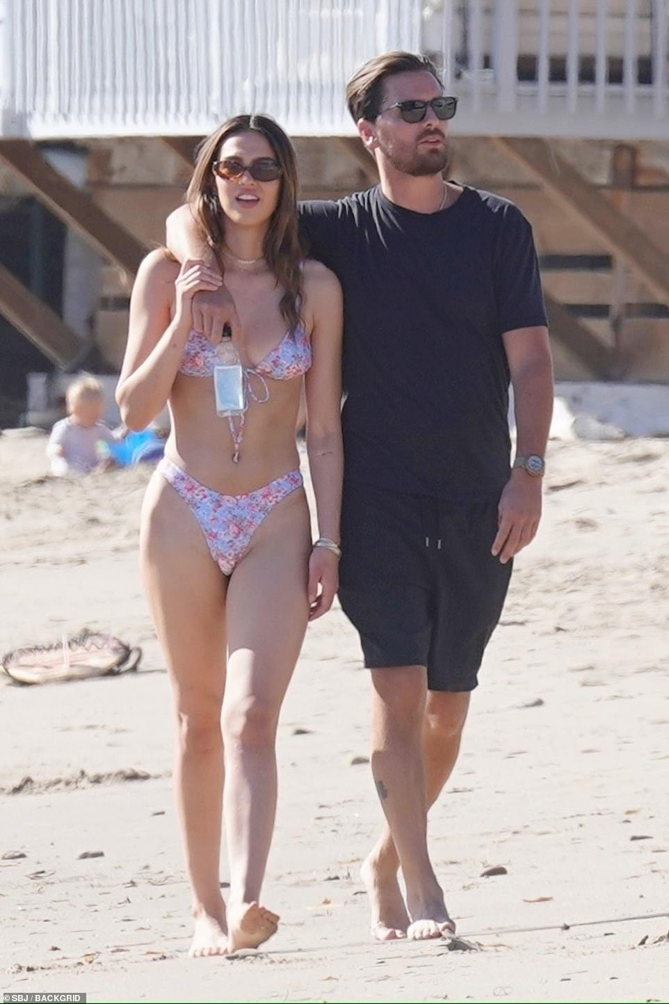 Scott Disick, 37, puts his arm around a bikini-clad Amelia Hamlin, 19, in Malibu