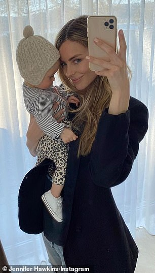 Proud mum: On Tuesday,Jennifer Hawkins shared a gorgeous picture of her daughter, Frankie Violet, taking a nap on her chest
